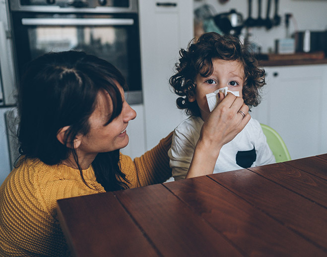 Child and mom stopping bloody nose