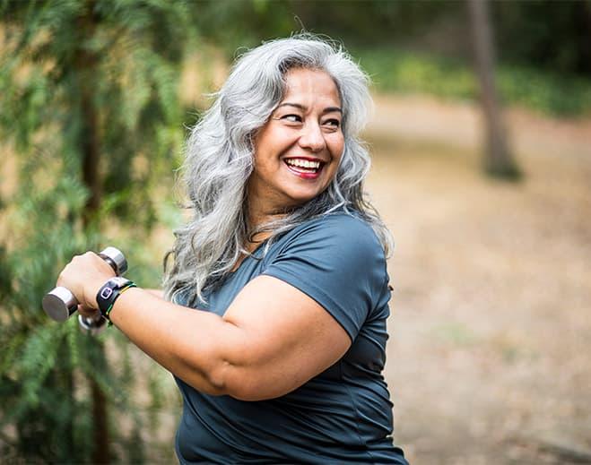 Mature Woman Exercising Outdoors
