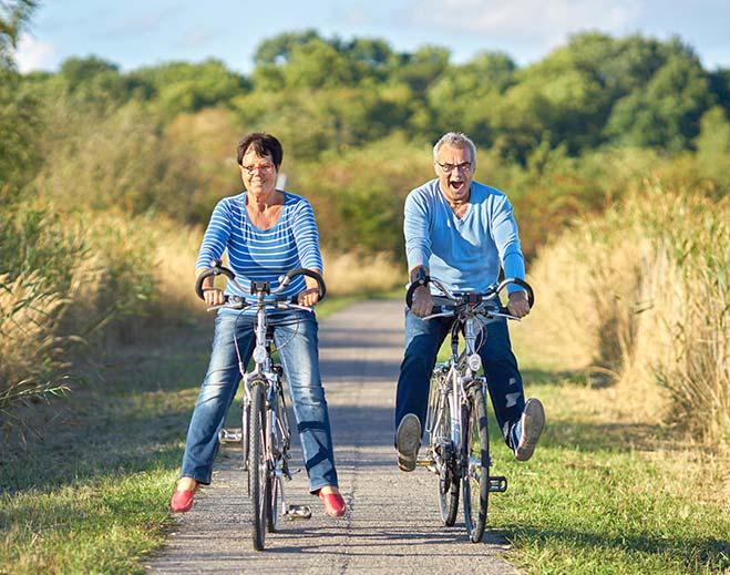 man and woman riding bikes